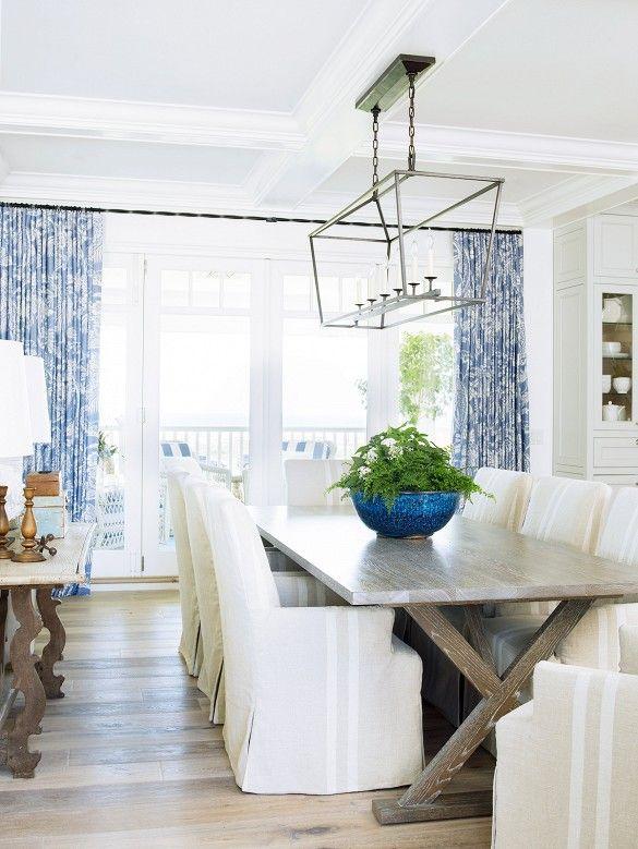 coastal living showhouse - x base table, slipcovered chairs, blue & white window panels, light fixture