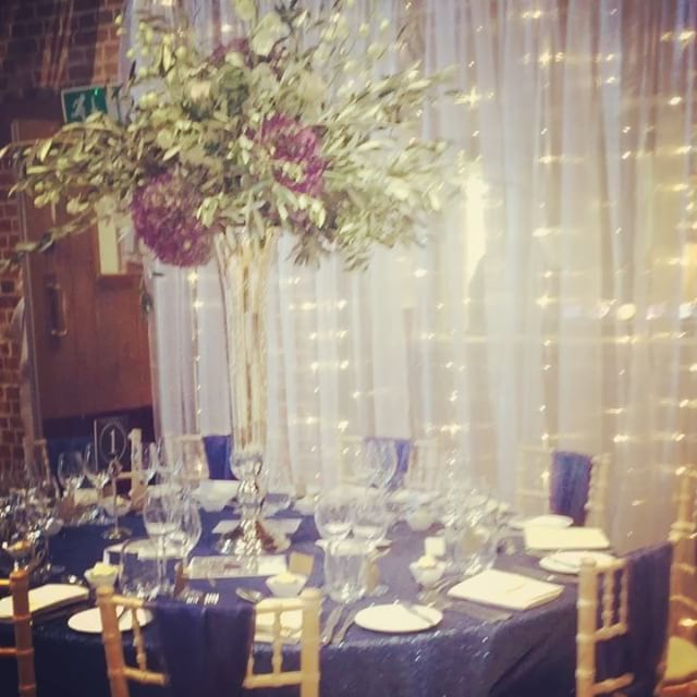 Deep ocean blue sequins and a stunning tall silver vase with greenery and hydrangeas amongst the beauty set against a twinkling backdrop. Styling by @venuestylist and flowers by @lilyandmay #gaynespark #throwback #gaynesparktastingevent #gaynesparknominatedsuppliers #sequins #olive #hydrangeas #blue #backdrop