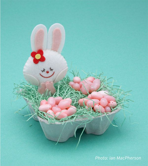 Take an empty egg carton, and pack it with vintage paper grass and some pretty jelly beans. Be creative and give some thought to what goes into your Easter gift.