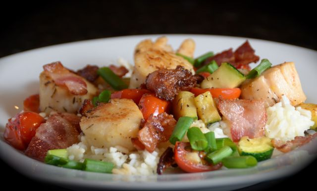 """Frankly, Scallop, I don't give a Clam!"" Hardy, Har, Har. Did you ever have those little bacon wrapped scallop appetizers? This meal has the same flavors, with the addition of some vegetables and r..."