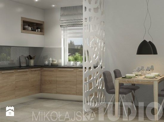 Oddzielenie kuchni od salonu cienkim elementem (akurat ten sie nam nie podoba), zeby nie tracic miejsca