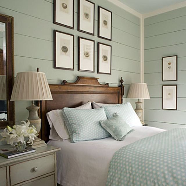Love the color of the walls with the antique bed..and I love painted wood paneling