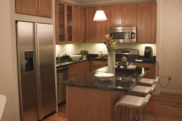 One little-known avenue for finding inexpensive kitchen cabinets: display kitchen cabinets in kitchen/bath showrooms.