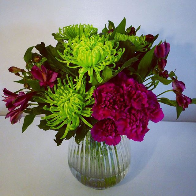 Bright corporate vase arrangement in greens and pinks.
