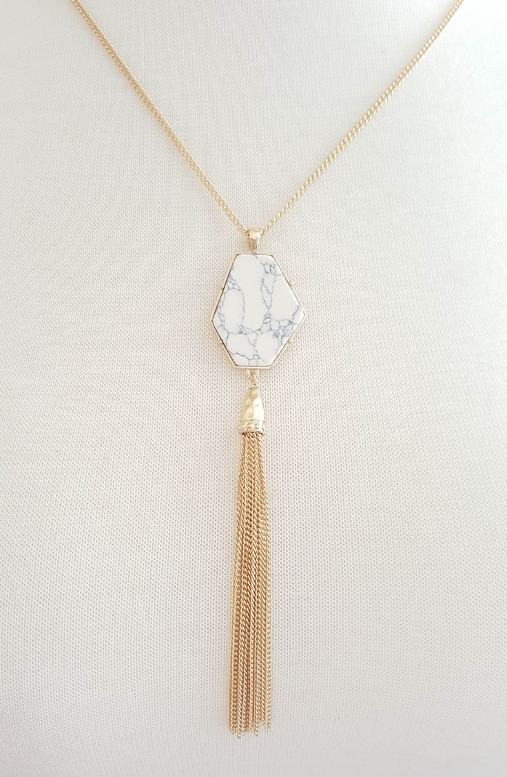 "Veined faux marble necklace with metallic tassels. 15""L 3""L Extension With Ball End Lobster Closure High Polished Finish Light To Medium Weight"