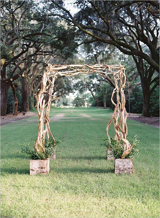 simple twisted wood wedding arch #weddingceremony #ceremonyarch #weddingchicks http://www.weddingchicks.com/2014/03/20/elegant-wedding-at-the-legare-house/