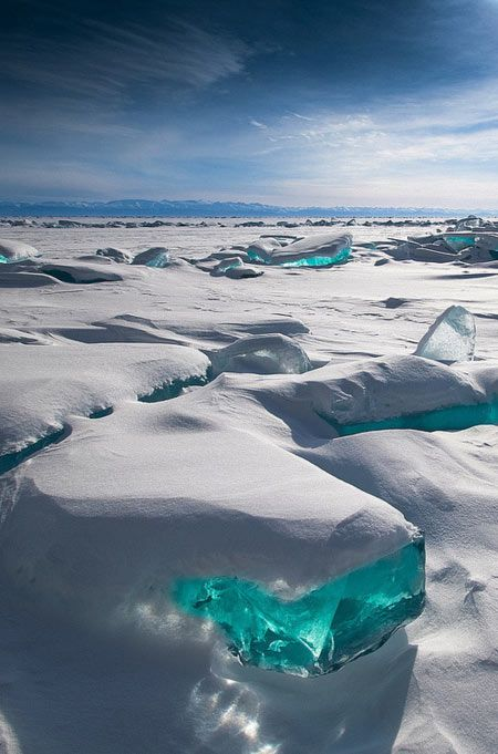 IFLS: Lake Baikal in eastern Siberia is the oldest freshwater lake on Earth, and one of the largest and deepest, containing around one-fifth of the world's freshwater. In winter, it freezes over, and these beautiful transparent, turquoise masses of broken ice appeared in March 2013, caused by the unequal structure, temperature and pressure in the main body of the packed ice.