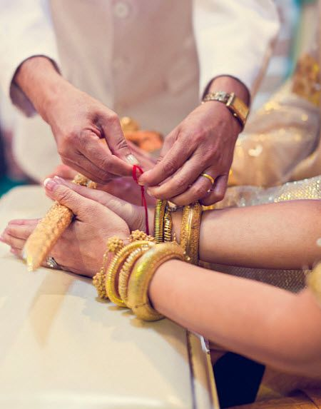 In a traditional Cambodian wedding, the parents of the bride & groom tie a piece of yarn around each of their wrists, symbolizing their blessing for a long & happy marriage.