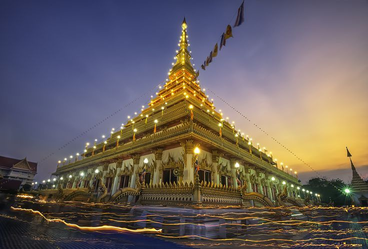 Candle lit top of golden pagoda at the Thai temple, Khon kaen Thailand by Extra suriyachat on 500px