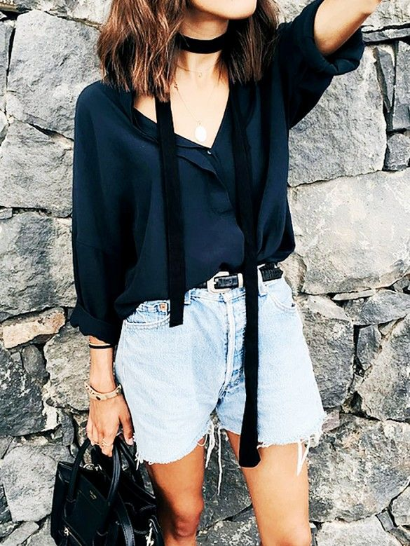 A button-down is worn with belted raw-hem denim shorts, a satchel bag, and a skinny scarf: