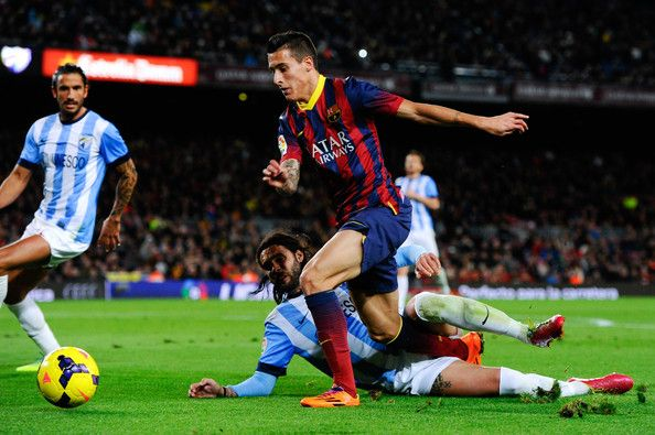 Cristian Tello of FC Barcelona duels for the ball with Sergio Sanchez of Malaga CF during the La Liga match between FC Barcelona and Malaga CF at Camp Nou on January 26, 2014 in Barcelona, Catalonia.