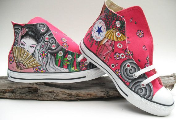This pair of pink converse is hand painted with a geisha holding a fan and an umbrella and surrounded by cherry blossoms.  Completely hand painted with professional grade acrylics. No stencils used.