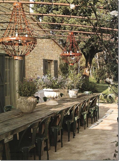 garden living. creating living space outside. chandeliers outdoors