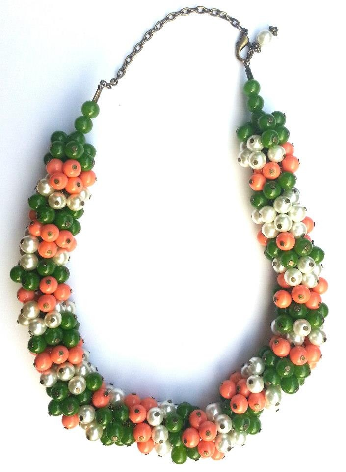 Statement necklace created from white, coral and emerald green pearls.        www.facebook.com/SimplicitybyMelanie