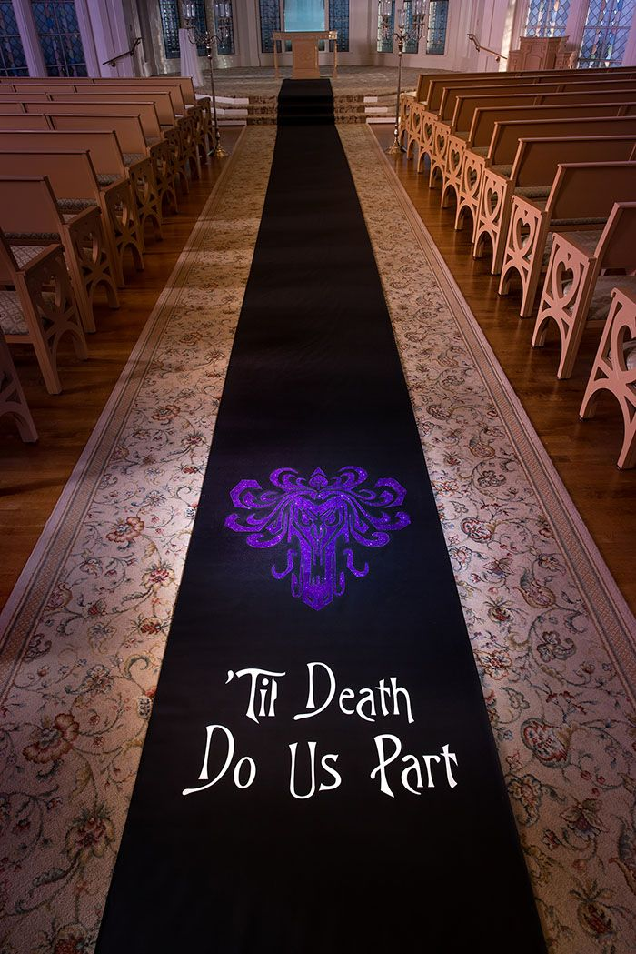 Custom aisle runner at Disney's Wedding Pavilion inspired by Halloween and The Haunted Mansion