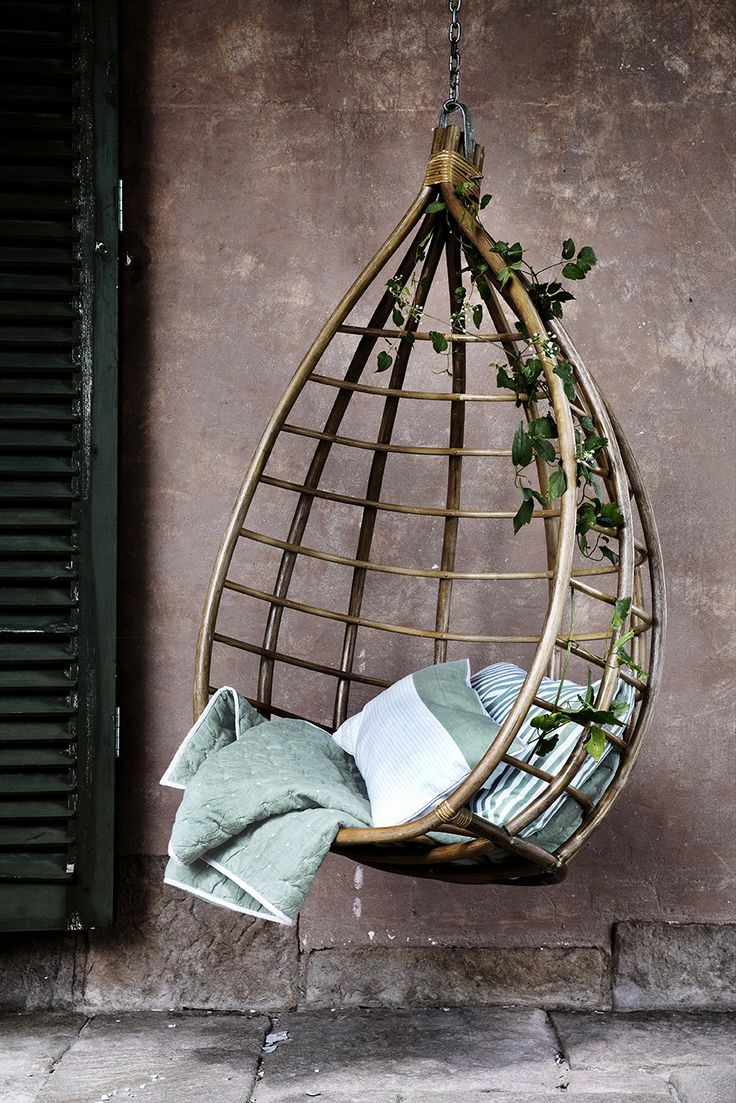 gorgeous hanging chair, I wonder if it would be possible to have a potted plant above this, something to grow a vine of morning glories that could climb down around it.