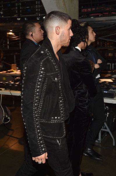 Nick Jonas Photos Photos - Singer/Actor Nick Jonas walks backstage at The 59th GRAMMY Awards at STAPLES Center on February 12, 2017 in Los Angeles, California. - The 59th GRAMMY Awards - Backstage
