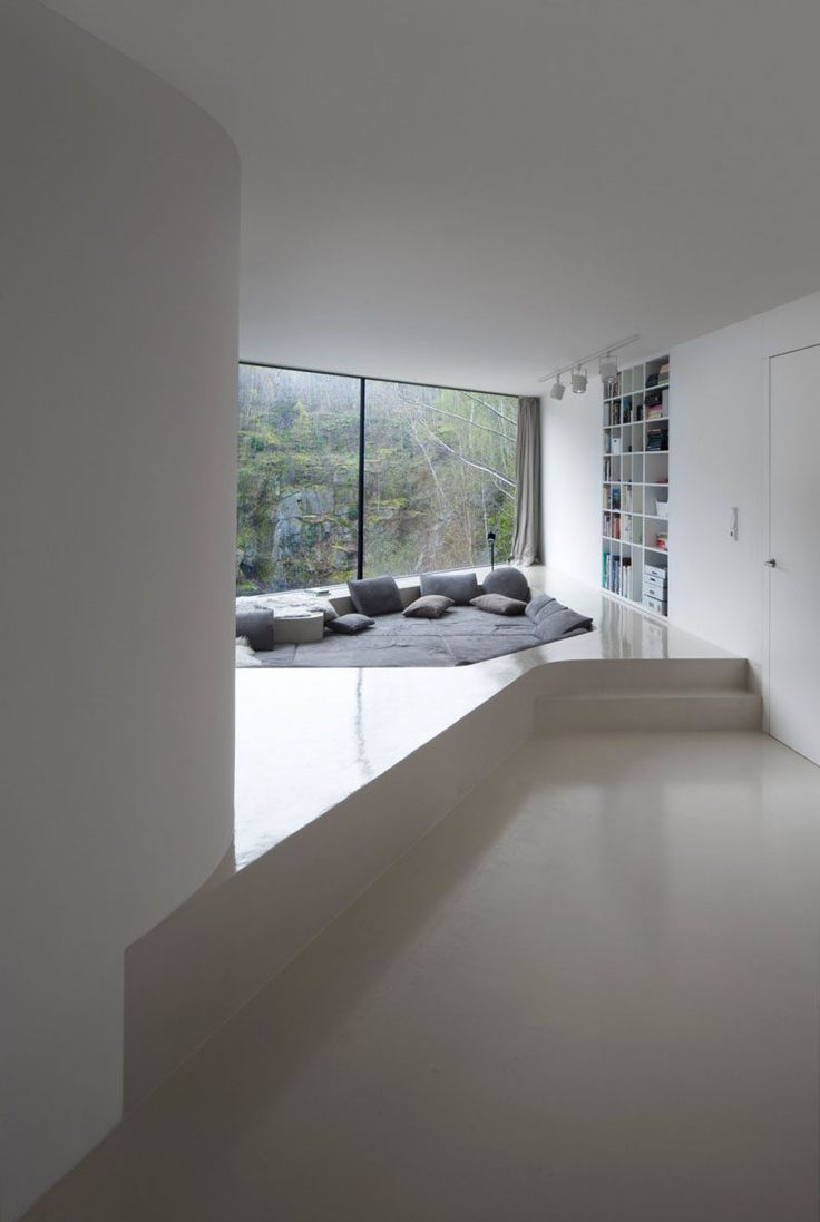 This comfy lounge area has been sunken into a built-up floor …