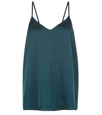 Tall. This dark green satin cami is ideal for evening looks. Tuck into black trousers and finish with ankle strap heels.- Satin fabric- V neckline- Shoestring straps- Casual fit that is true to size- Model wears UK 10/EU 38/US 6 Tall size guide:UK size 8: Bust - 84cm, Waist - 66cm, Hips - 90cmUK size 10: Bust - 88cm, Waist - 70cm, Hips - 94cmUK size 12: Bust - 93cm, Waist - 75cm, Hips - 99cm UK size 14: Bust - 98cm, Waist - 80cm, Hips - 104cm UK size 16: Bust - 105cm, Waist - 87cm, Hips…