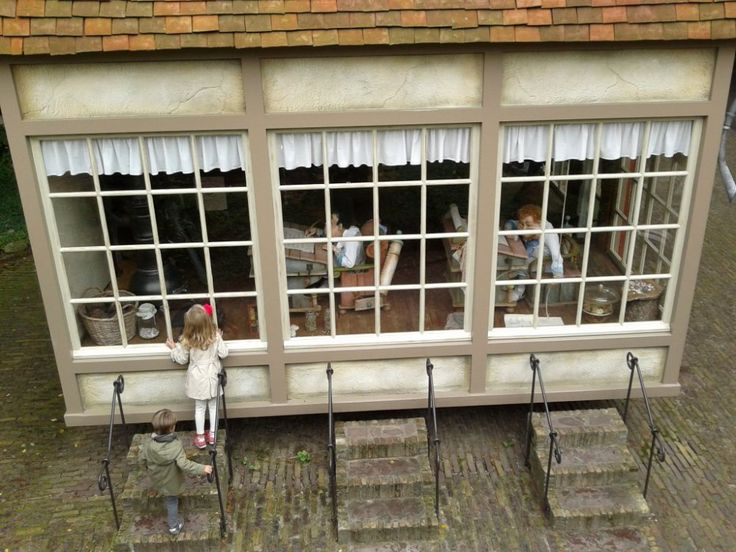 Two kids looking through a school window in Efteling.  Find more pictures in: http://allibreathe.wordpress.com/