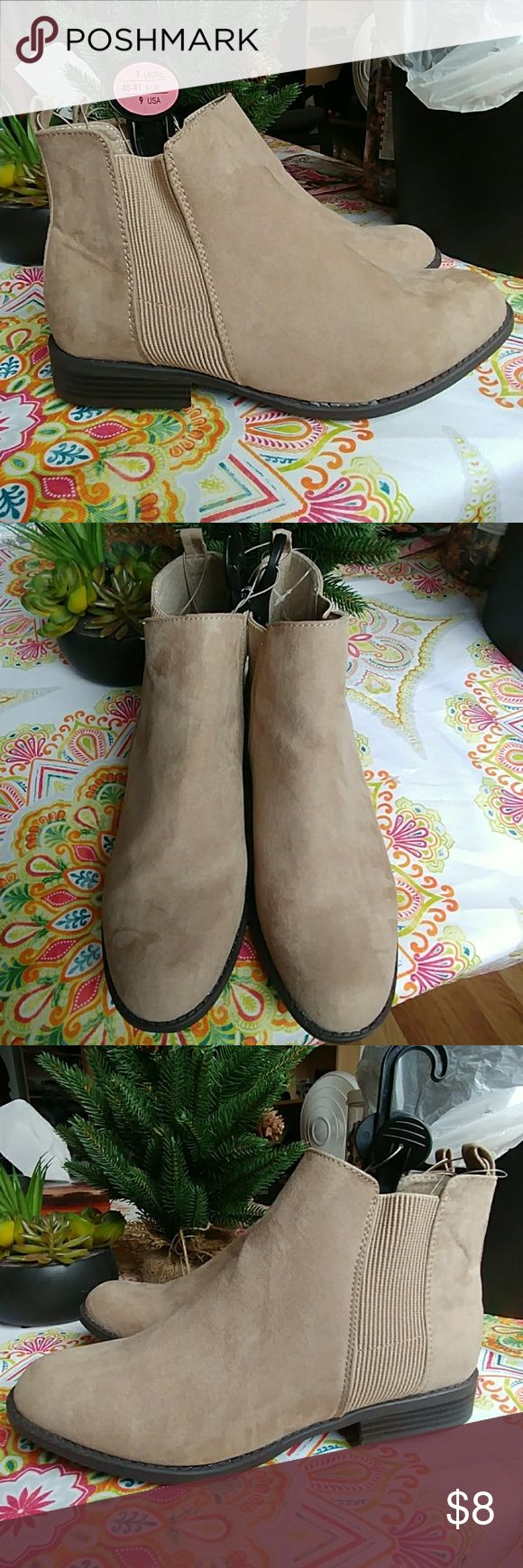 PRIMARK SUEDE BOOTIES-SIZE 9 US-NEVER WORN-NWOT About: -These booties have a suede like exterior and are smooth to the touch.  -Size 9 US Size 7 UK Size 40/41 EU -Never worn! Tried on. Tag was taken off but comes with original hanger indicating size.  -They rest about an inch over the ankle.  -Heel is an inch thick.   Need more pictures? Have questions? Anything else about these boots; feel free to leave a comment below and I will do my best to get back asap. Primark Shoes Ankle Boots…