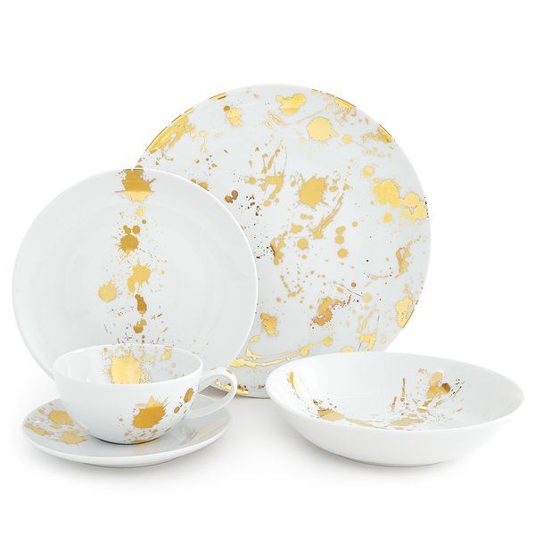 Chic and classique porcelain dinnerware in a generous scale and friendly coupe shape with a surprising splatter of solid gold. With its all-over splatter pattern, the dinner plate is like a sparkly neutral while the other pieces are embellished with a bold composition.