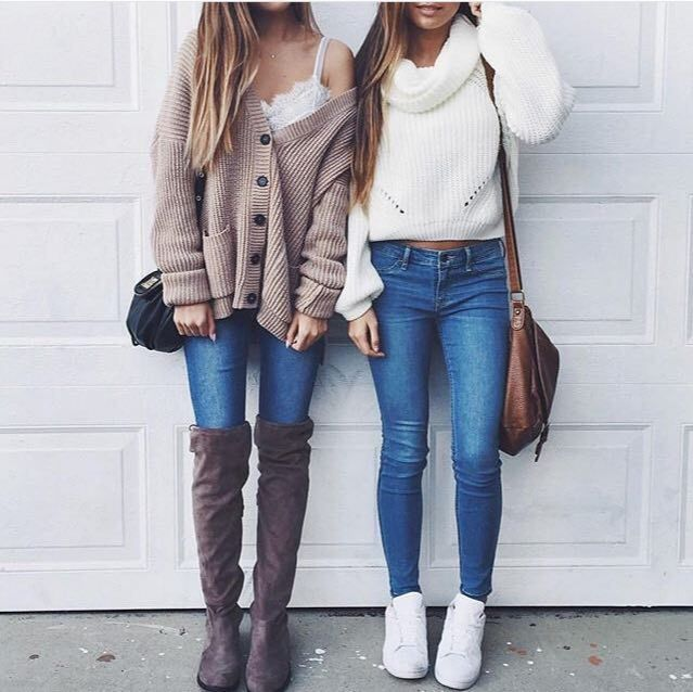 Dark Beige Button Up Cardigan with Skinny Leg Jeans, a White Crop Top, Knee High Purple-Brown Suede Boots, and a Black Hand Bag; White Rolled Collar Sweater with Blue Skinny Jeans, a Brown Handbag, and All White Sneakers