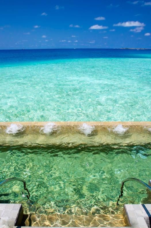 The Velassaru Resort in the Maldives offers pools that spill out into the ocean. Picture / Supplied