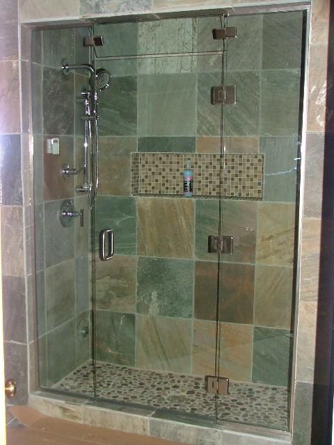 A single frameless shower door beckons one into a sleek tile or rustic, stone room, illuminating the walled enclosure with light. It's the simplest upgrade to increase value and a touch of luxury.
