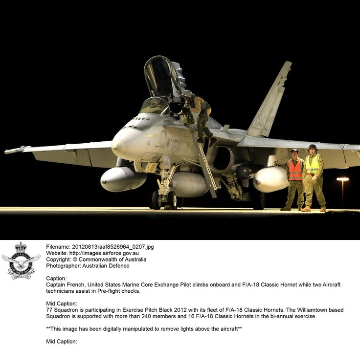 20120813raaf8526964_0207.JPG    Captain French, United States Marine Corps Exchange Pilot climbs on board and F/A-18 Classic Hornet while two RAAF Aircraft technicians assist in Pre-flight checks.  **This image has been digitally manipulated to remove lights above the aircraft**  © Commonwealth of Australia