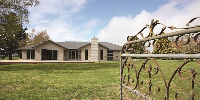 A century-old gate joins the family home to its surrounding farmlands.