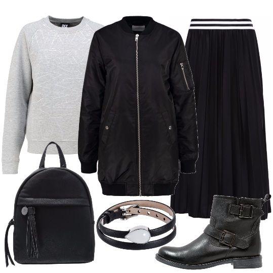 Vi piace lo stile metropolitano e amate le gonne? allora questo è il look che fa per voi: felpa grigia da indossare con la gonna lunga, sopra indossiamo il grintoso bomber. Gli accessori completano il tutto in modo perfetto: stivaletti, zainetto nero e bracciale.