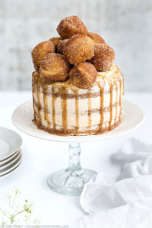 Sugar and spice cake with mascarpone frosting and cinnamon caramel topped with mini donuts | Supergolden Bakes