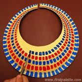 """Egyptian Collar: Position large paper plate bottom side up. Trace hole, cut & cut vertical slit. Once you are happy with the collar's fit, paint it gold. Paint short strokes to form each row or layer of """"beads"""". Paint more rows of colors until you have decorated the entire collar. X"""