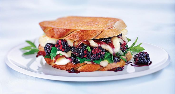 The Bewitching grilled cheese | This magical concoction features fresh blackberries, peppery greens, crispy fried bacon, and lusciously molten Wisconsin Provolone and Gouda.