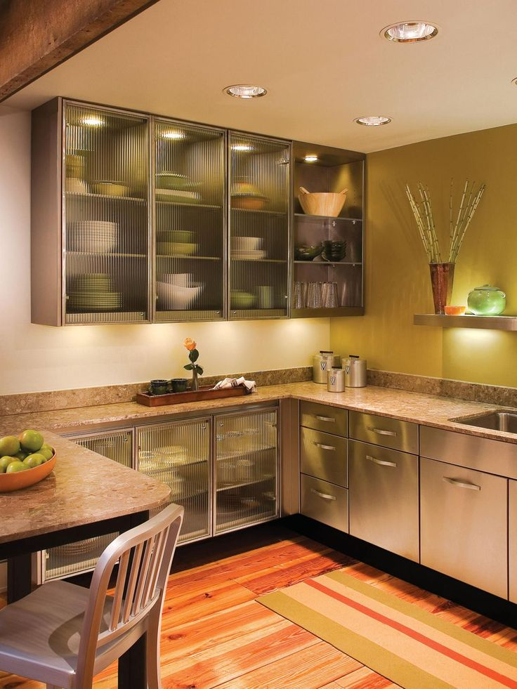 modern kitchen with glass cabinet doors and granite countertops