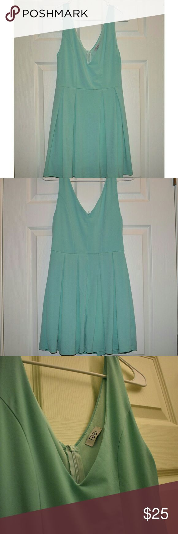 TOBI low neck dress in teal/blue Beautiful TOBI dress that is perfect for a daring date night or a fancy event. Very low neck.  Excellent condition and beautiful color, pictures don't do it justice. Tobi Dresses Midi