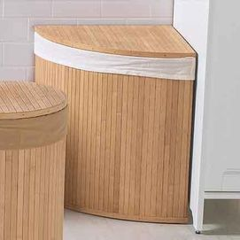 Corner wooden laundry hamper. helps get rid of the eye sore that laundry bins can be