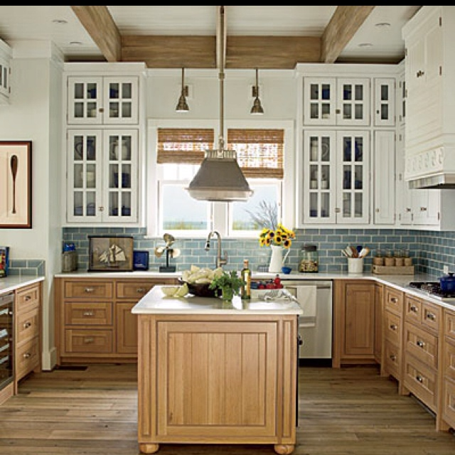 inspiration kitchen - two toned cabinets white up top, light wood color on the bottom.
