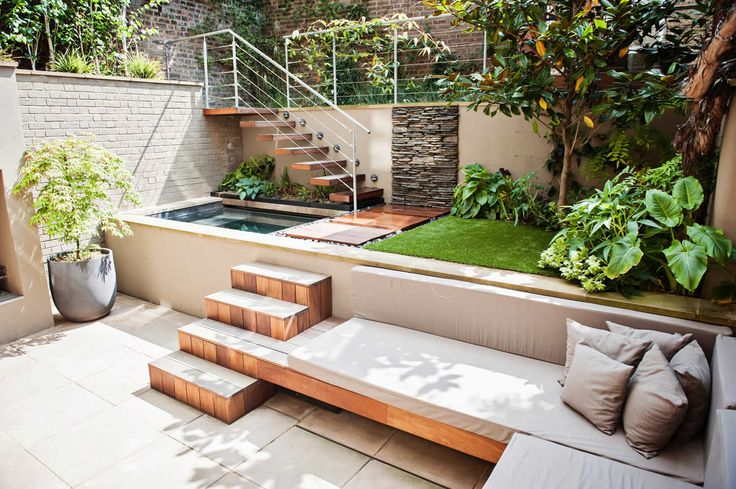 Love this built in seating &stairs // City Garden by The Garden Builders