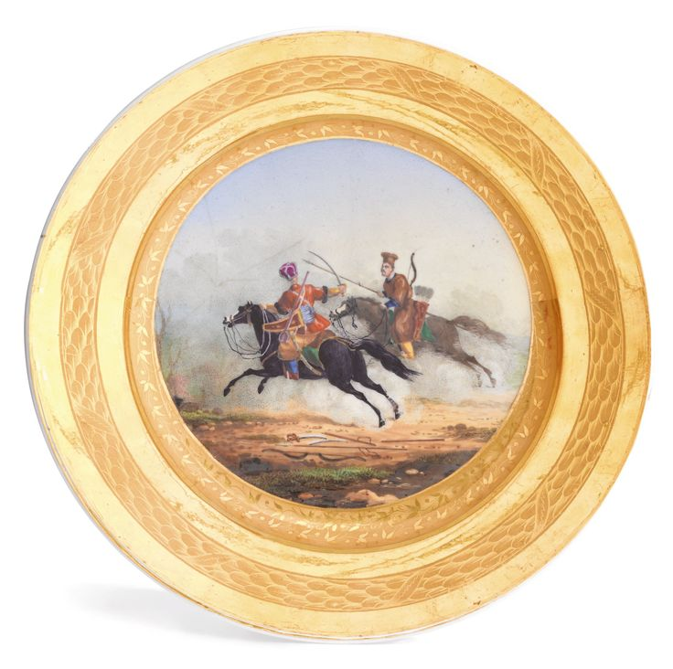 The Battle of Borodino: A porcelain military plate, Gardner Manufactory, Verbilki, late 19th century-   the cavetto painted with a charging Kuban Tatar and Kalmyk, gilt foliate border, with blue and impressed factory marks and impressed number 33  diameter 23.5cm, 9 1/4 in.