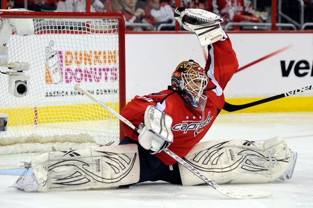 Capitals goalie Braden Holtby makes a save against the Bruins during Game Four of the Eastern Conference Quarterfinals. Holtby made 44 saves on the night as Washington prevailed 2-1 to even the series at 2-2. (Patrick McDermott/Getty Images)