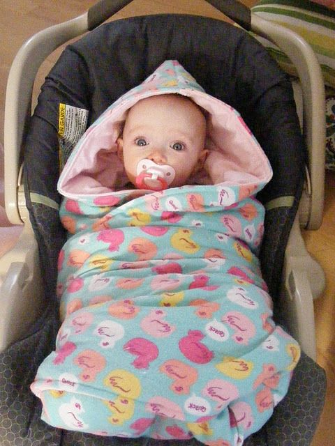 Smart! A car seat blanket! It's a pattern to sew a blanket with holes for car seat buckles. Put in the blanket, then the baby, then buckle, then wrap up the baby!