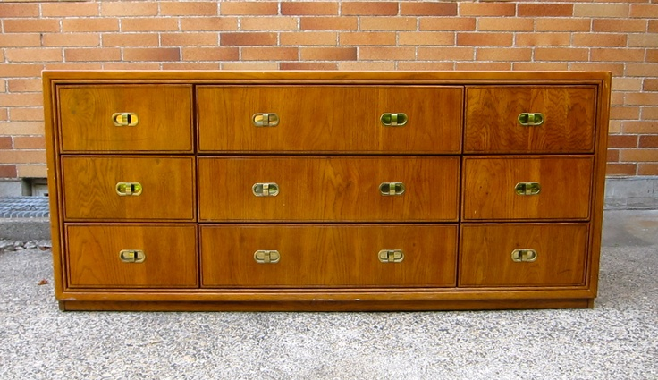 1960's oak dresser with vanity. Brass handles and plate glass mirror.