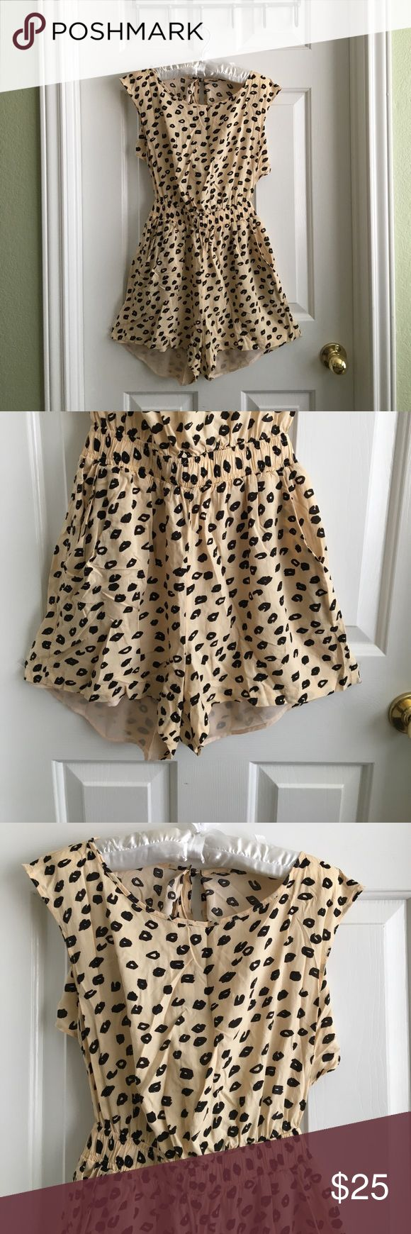 BCBGeneration semi backless cheetah romper Nude cheetah romper also had a nude lining in the shorts Dresses