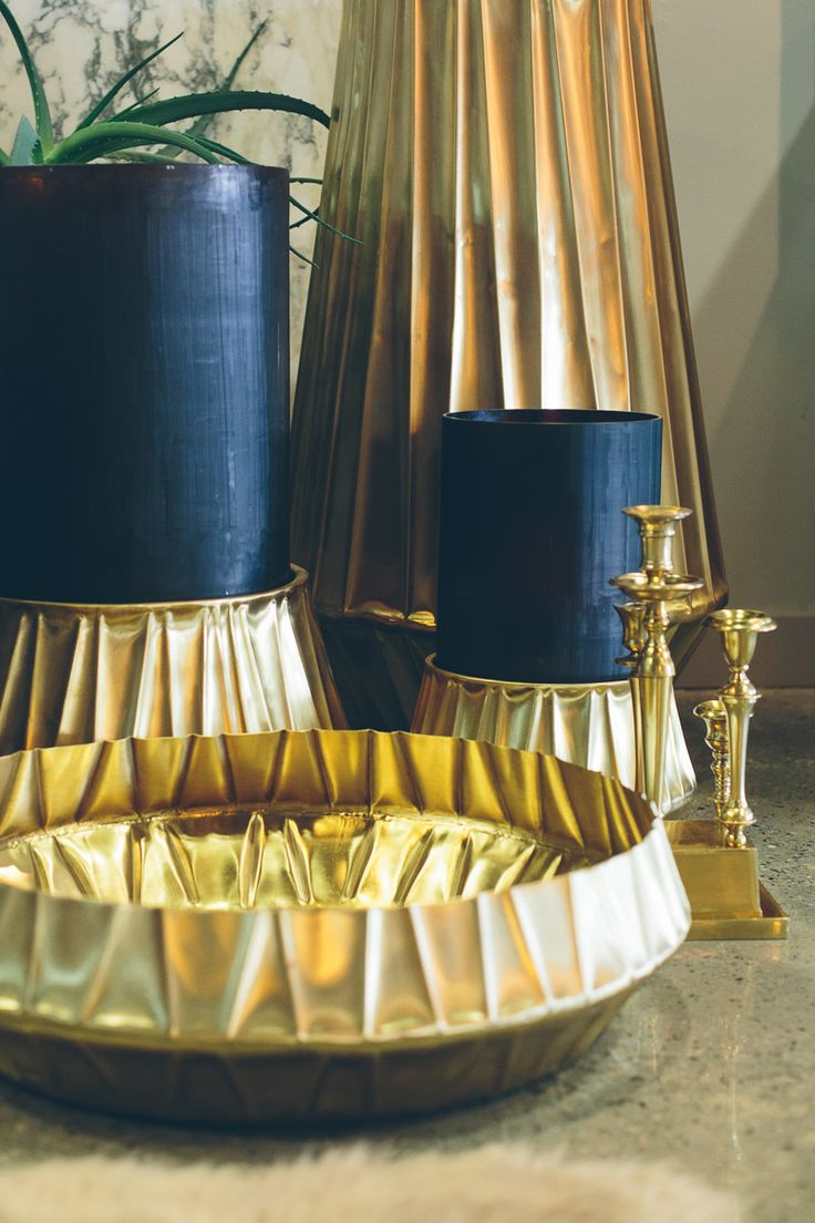Brass brilliance from Guax with hand made glass Hurricane lanterns and beautifully beaten vessels.