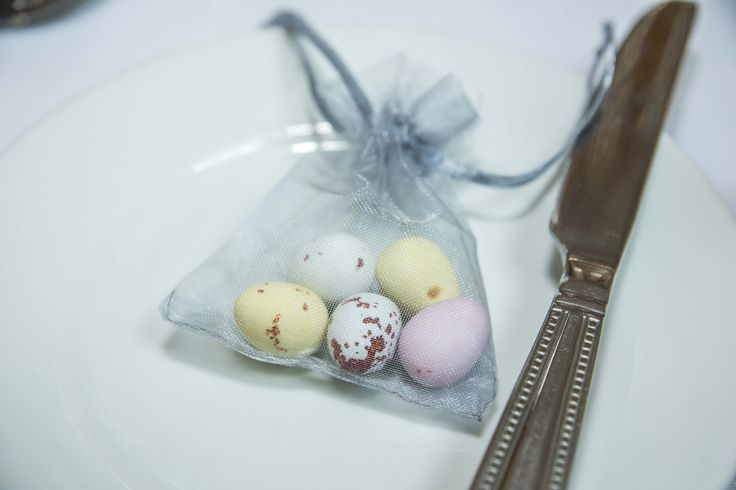 Simple bag filled with chocolate egg sweets.
