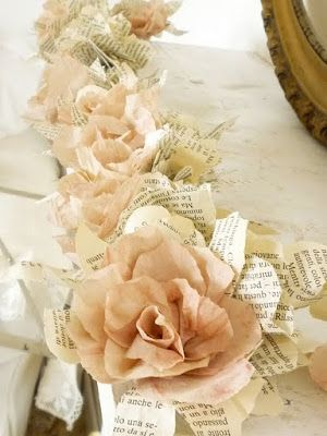 ~ beautiful paper flower garland from old books~ I think using sheet music could be quite lovely, too. :)