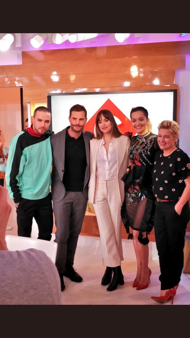 Picture of #dakotajohnson and #jamiedornan with #Liam and #ritaora at C à Vous tonight in Paris, France. #fiftyshadesfreed