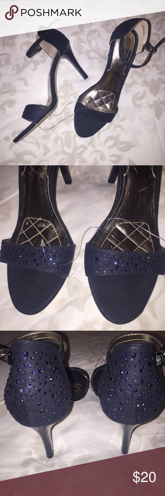 Blue gem heels Never worn, right shoe does have some damange on sole but its not noticeable while wearing. All gems seem to be intact, there are no major parchy areas. Heel is about 3 inches Alfani Shoes Heels